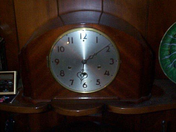 "12: Seth Thomas Art-Deco mantle clock. Measures 9"" high"