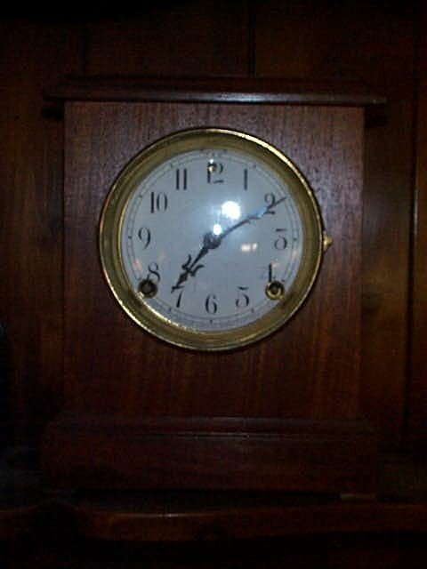 13: Sessions mantle clock with porcelain face dial. Com