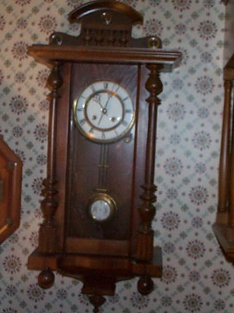 18: German Victorian style wall clock has pendulum and