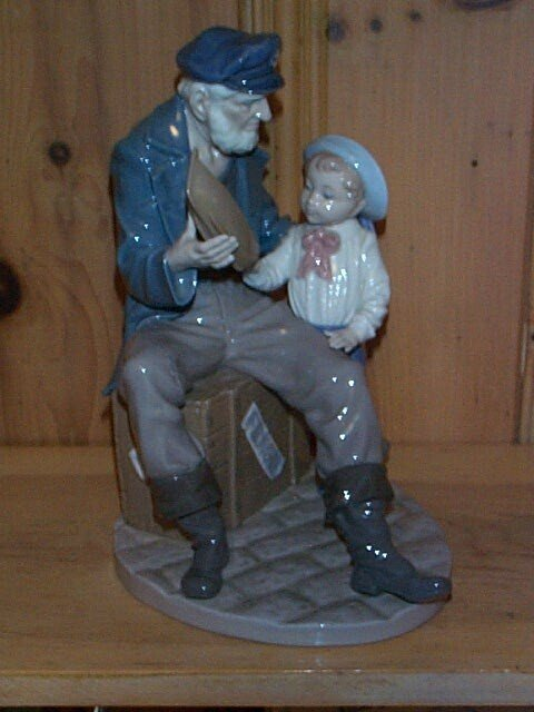 5: Lladro figurine depicting a sailor with young boy pl