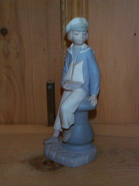 6: Lladro figurine depicting a young sailor boy holding