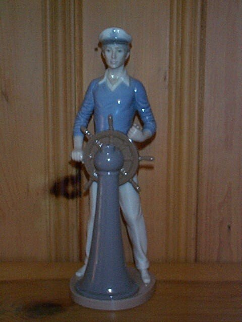 10: Lladro figurine depicting a man steering a ship, ma