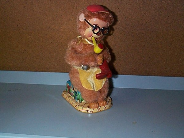 1508: Battery Operated Monkey Seated Smoking Pipe and c