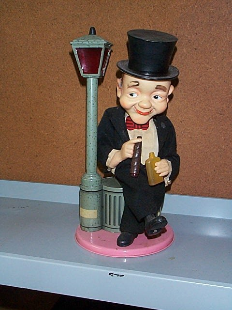 1509: Seated Man in Top Hat Battery Operated Dust Bin T