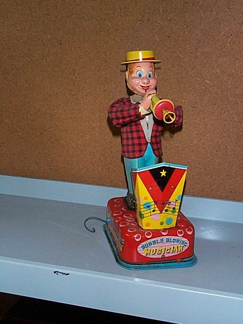 1511: Battery Operated Bubble Blowing Musician Toy. Buy