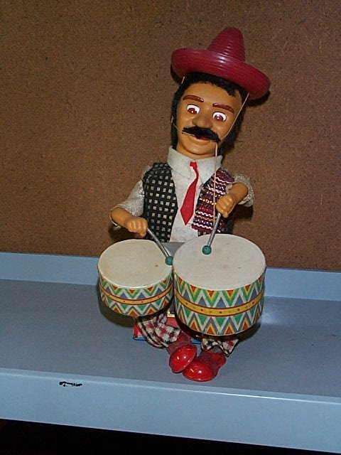 1512: Alps Battery Operated toy Mexican Drummer. Buyer