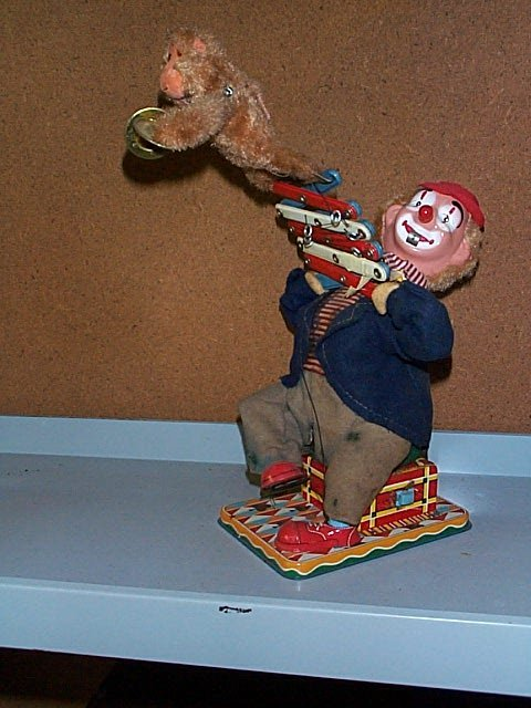 1518: Battery Operated Toy Clown with Jumping Monkey. B