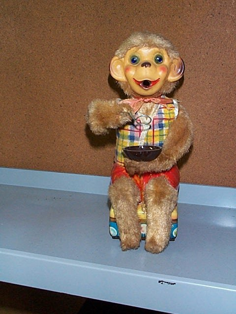 1519: Battery Operated Toy Monkey Blowing Bubbles. Buye