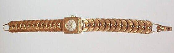 14: 14K Ladies Omega Wrist Watch