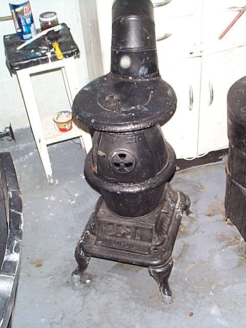 "99O: Umco #210 Cast Iron Pot Belly Stove. Stands 26"" by"