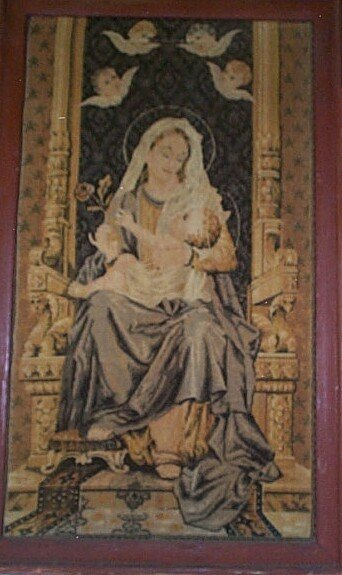 14: Framed tapestry depicting Mary holding Jesus with a