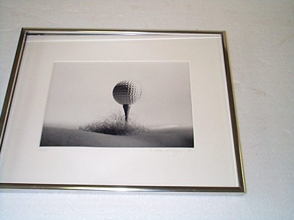 15: Black and white photograph depicting a golf ball te
