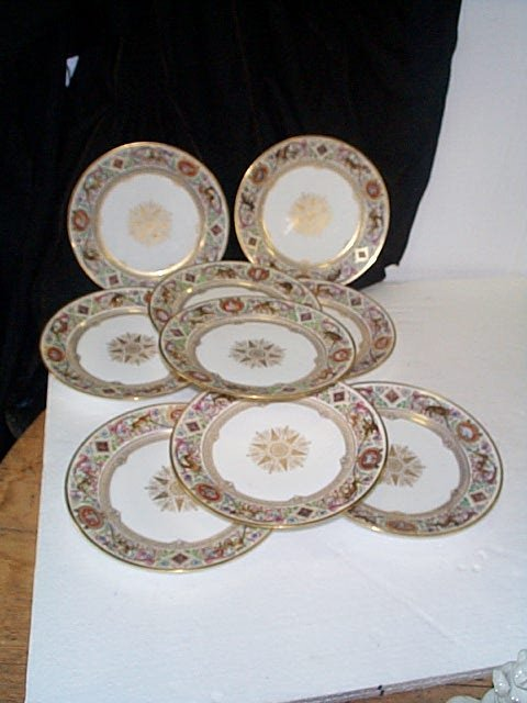 368: Set of nine hand painted Sevres plates.  Plates ar