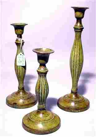 SET OF THREE VERDEGRIS FINISHED BRASS COLUMNAR CAND
