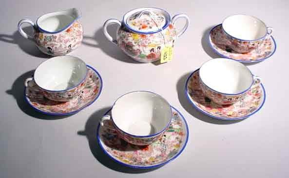 422: TEN PIECE FLORAL DECORATED TEA SET