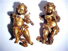 744: PAIR OF GILDED COMPOSITION PUTTI FIGURED WALL ORNA