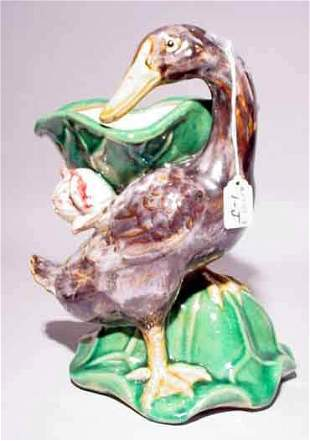 MAJOLICA DECORATED AND GLAZED PORCELAIN FIGURAL PLA