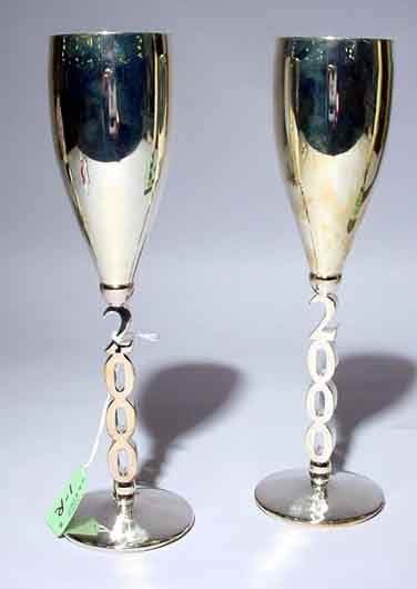 1R: SET OF FOUR SILVERPLATED MILLENNIUM CHAMPAGNE FLUTE