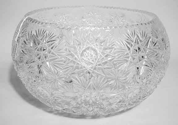 406: LARGE CUT GLASS ORB FORM BOWL