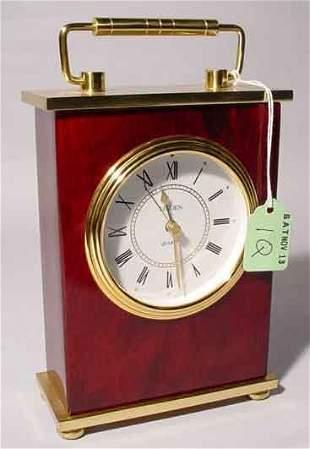 SMALL QUARTZ TABLE CLOCK, having a polished brass a