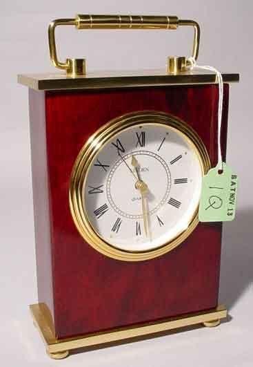 1Q: SMALL QUARTZ TABLE CLOCK, having a polished brass a