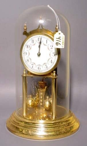 416: GERMAN POLISHED BRASS ANNIVERSARY CLOCK WITH GLASS