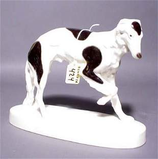 DECORATED PORCELAIN FIGURE OF A GREYHOUND, by Schn
