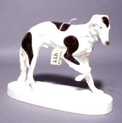 424: DECORATED PORCELAIN FIGURE OF A GREYHOUND, by Schn