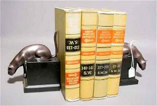 1T: PAIR OF POLISHED BRONZE FINISHED BRASS FIGURAL BOOK