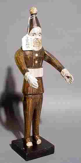 402B: FOLK ART CARVED AND DECORATED WOOD FIGURE OF SANT