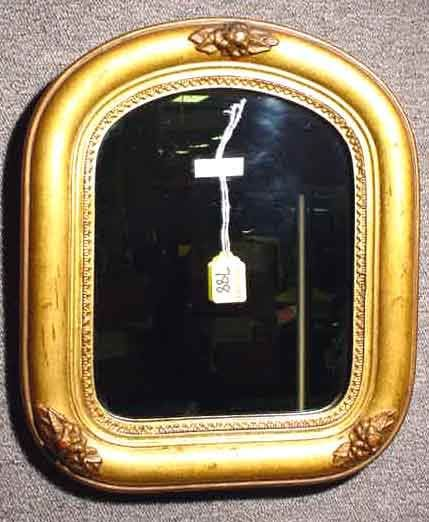 408: SMALL GILT FRAMED WALL MIRROR; 12 inches by 14 inc