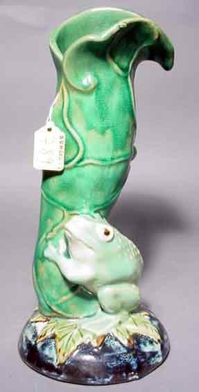 789: MAJOLICA GREEN GLAZED FIGURAL VASE, modeled as a l