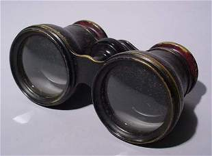 PAIR OF CLAIRMONT, NY LEATHER ENCASED OPERA GLASSES
