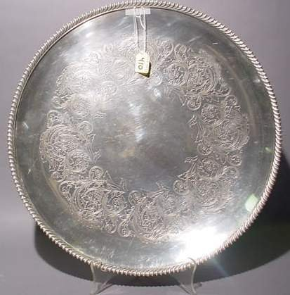 1410: SILVERPLATED CIRCULAR ENGRAVED TRAY, having a gad