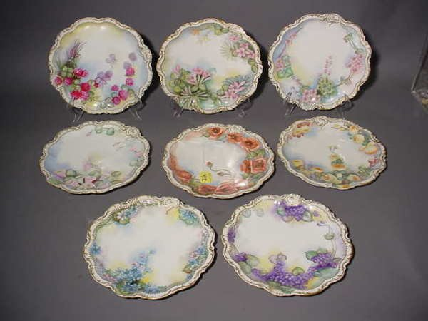 1412: SET OF TEN LIMOGES DECORATED CIRCULAR LUNCHEON PL