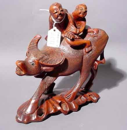 2011: CHINESE CARVED TEAKWOOD GROUP, late 19th century,