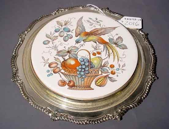 2016: DECORATED PORCELAIN AND SILVERPLATED TRIVET, the