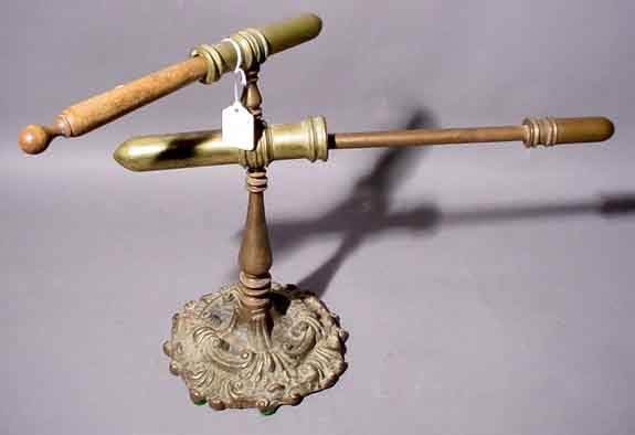 2365: ANTIQUE BRASS CURLING IRON, late 19th century, se