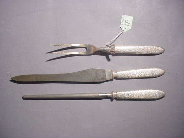 THREE-PIECE SILVERPLATED CARVING SET, having an etc