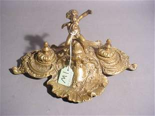 CAST POLISHED BRONZE ROCOCO STYLE PUTTO FIGURED INK