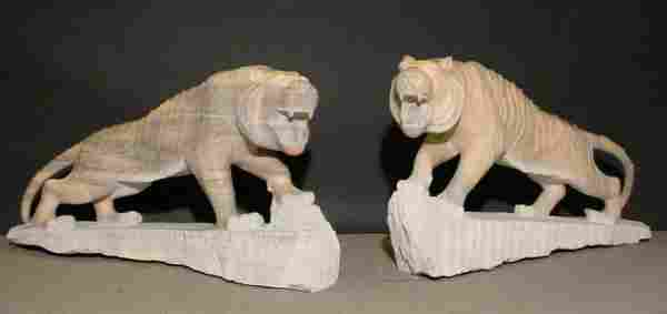 PAIR OF FINELY CARVED LIFESIZE ROSE SIENNA MARBLE