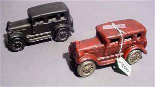 PAIR OF HAND PAINTED CAST IRON TOY CARS, modeled a