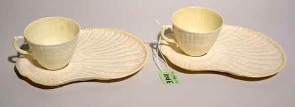 1001E: PAIR OF IRISH BELLEEK T.V. SETS, of shell form,