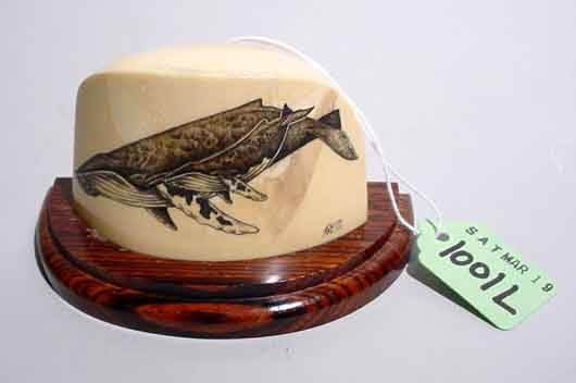 1001L:  SCRIMSHAW CARVED SECTION OF A WHALE'S TOOTh