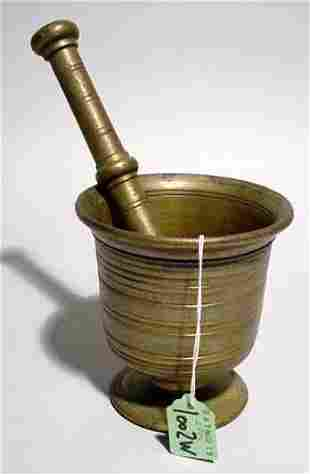 PATINATED BRONZE MORTAR AND PESTLE, having a tur