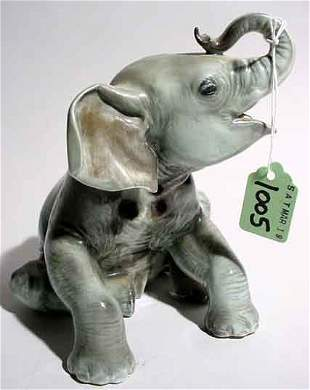 ROSENTHAL PORCELAIN SCULPTURE OF A SEATED ELEPHAN