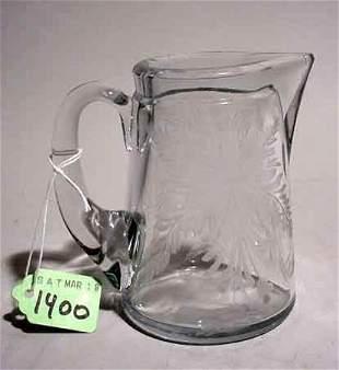 ACID ETCHED MOULDED GLASS CREAMER, having an elab