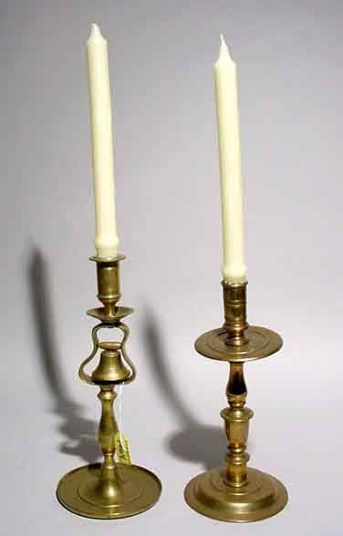1404: LOT OF TWO POLISHED BRASS CANDLESTICKS, one with