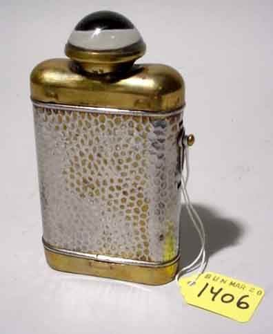 1406: SILVERPLATED AND POLISHED BRASS FLASK DESIGN FLAS
