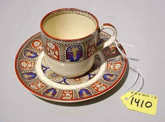 1410: WEDGWOOD DECORATED STONEWARE CUP AND SAUCER, ''In